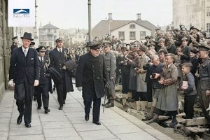 Winston Churchill made a stop in Iceland enroute back to England after attending the Atlantic Conference with President Roosevelt on 19 August 1941. Here, the Prime Minister can be seen being greeted by local Icelanders as he makes his way out of Parliament House.